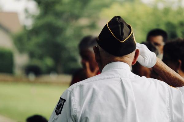 veteran saluting photo by sydney rae on unsplash