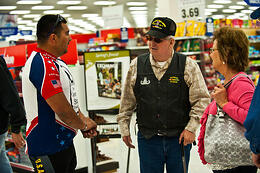 two veterans communicating while shopping in a store